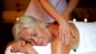 Senior Woman Having Massage In Spa video