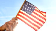 Senior Woman Holding American Flag video