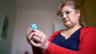 Senior Woman Holding An Easter Egg video