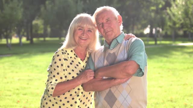 Senior woman hugging man. video