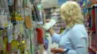 Senior woman in the hypermarket video