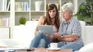HD DOLLY: Senior Woman Learning To Use Tablet video