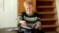 Senior woman looking photo video