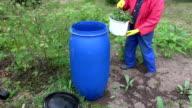 Senior woman making ecological garden fertilizer video