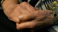 Senior woman massages painful hands video