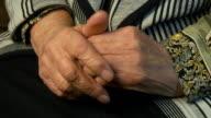 Senior woman massages painful hands video
