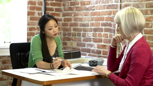 Senior Woman Meeting With Financial Advisor In Office video