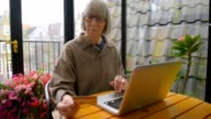 Senior woman online banking video