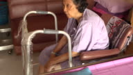 senior woman patient healing her knee surgical wounds video