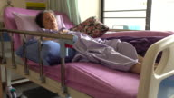 senior woman patient lying in sickbed at hospital video