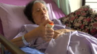 senior woman patient pressing emergency call at hospital video