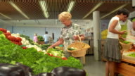 HD DOLLY: Senior Woman Picking Up Vegetables video