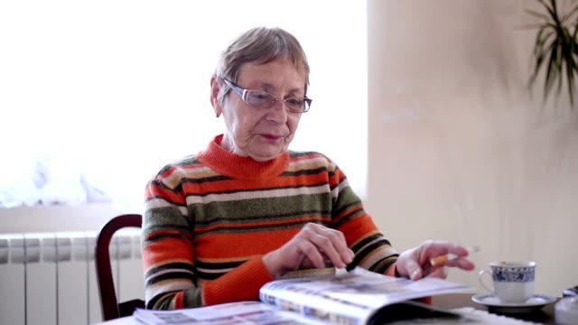 Senior woman reading magazine video