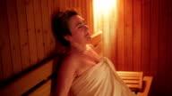 Senior woman relax in sauna video