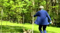 Senior Woman Running with Dog video