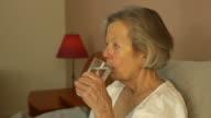 Senior Woman Takes Medicine video
