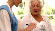 Senior woman talking to nurse video