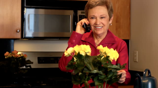 Senior Woman Talks on Telephone video