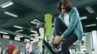 Senior woman tying shoelaces video