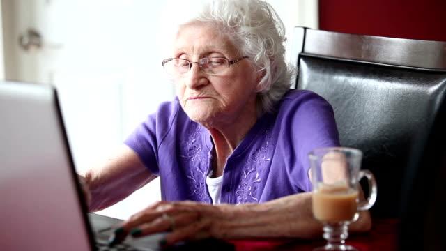 Senior Woman Typing On Laptop video