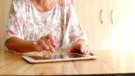 Senior woman using a digital tablet video