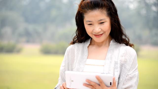 Senior Woman Using Digital Tablet video
