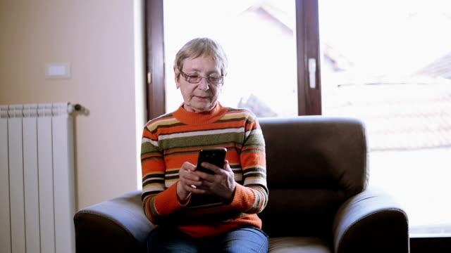 Senior woman using phone video