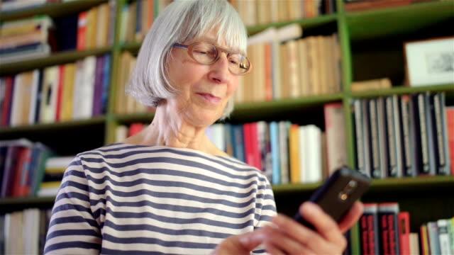 Senior woman using smart phone video
