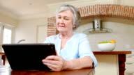Senior woman using tablet video