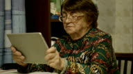 Senior woman using touch pad and talking video