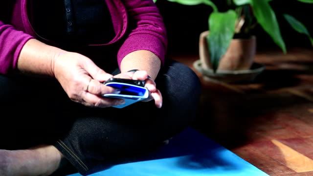 Senior Woman using Wearble Tech video