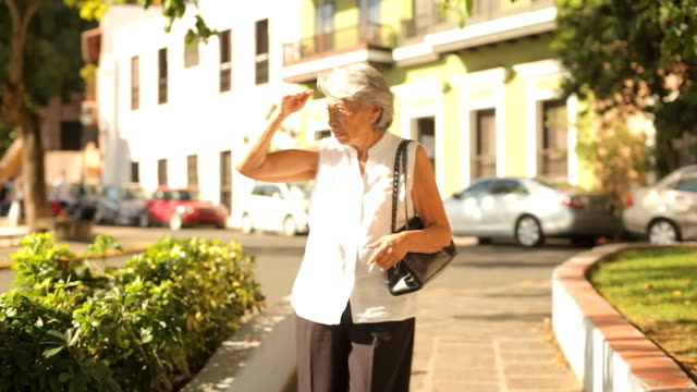 Senior woman walks alone video