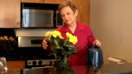 Senior Woman Waters Flowers video