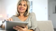 Senior woman websurfing with tablet video