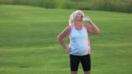 Senior woman with sports bottle. video