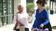 Senior women enjoying day in the city shopping together video