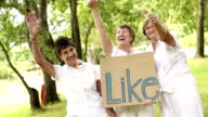 Senior women with a 'like' sign video