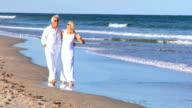 Seniors Barefoot on the Beach video