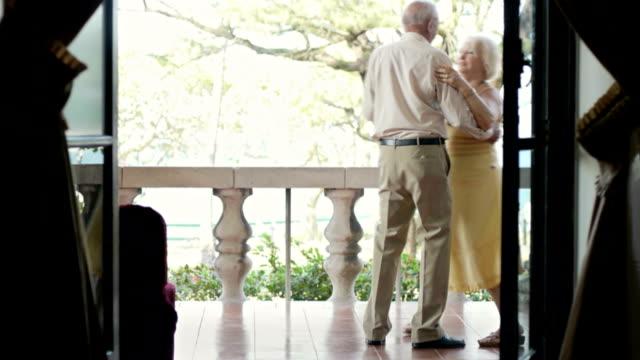 Seniors dancing in patio video