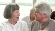 HD DOLLY: Seniors Enjoying Conversation In Community Center video