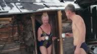 Seniors enjoying sauna tradition video