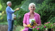 Seniors Gardening and Watering Plants video