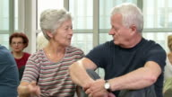 HD DOLLY: Seniors Having Conversation In Community Center video