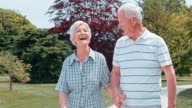 SLO MO Seniors laughing and holding hands on their walk video