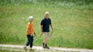 HD: Seniors Nordic Walking In Countryside video
