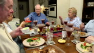 Seniors Pass Food Around Table video