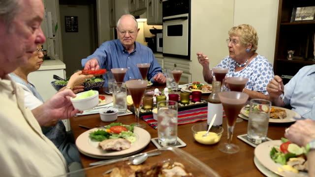 Seniors Pass Food Around Table video