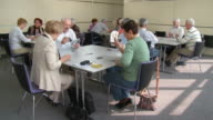 HD: Seniors Playing Cards In Community Center video