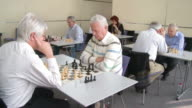 HD: Seniors Playing Chess In Community Center video