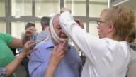HD: Seniors Practicing Head Bandaging video